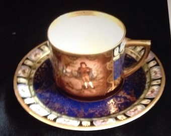 Royal Vienna style hand painted cup and saucer courting couple flowers decoration