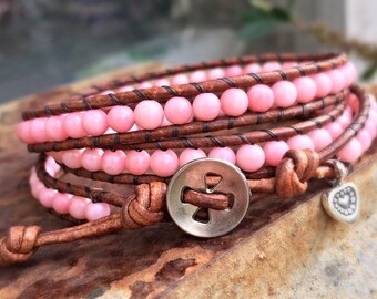 Wrap bracelet with bamboo coral beads on a vintage brown leather cord and a thai silver heart charm