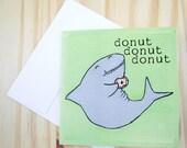 "CARD: ""Donut Shark 2, Shark Gets Donut!"" featuring a donut-loving shark and his jelly rolls"
