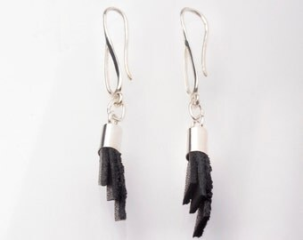Silver earrings and leather