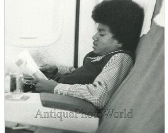 Young Michael Jackson on airplane rare vintage photo