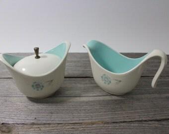 Beautiful mid-century modern ceramic cream and sugar set, light blue on white