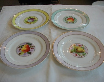 4 Beautiful Fruit plates to serve your favorite fruit or salad. Or hang for lovely wall decor