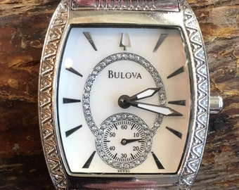 Stainless Steel Ladies Bulova Watch with Light White Pearlescent Face and Diamond Bezel (st - 1524)