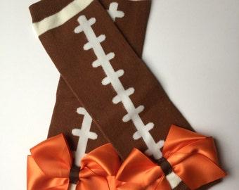 Cleveland football baby leg warmers, football leg warmers, Brown & white football leg warmers with orange satin bows, browns baby football