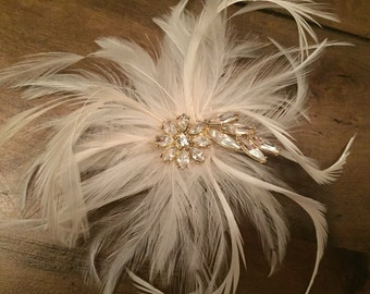 Ivory Bridal Feather Fascinator Hair Accessory.   Crystal and Gold Rhinestone center.