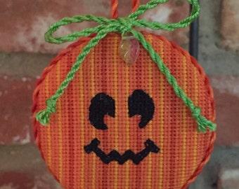 Halloween Jack-o-lantern Ornament - Completed Cross Stitch