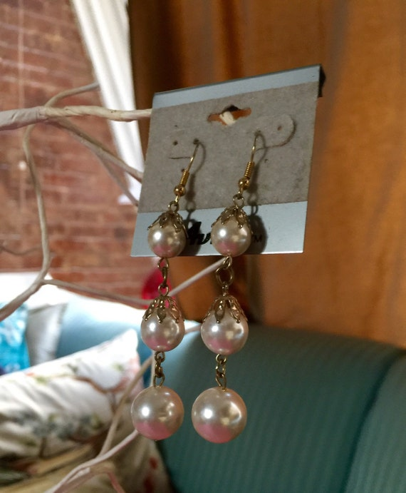 Glamourous Cascading faux pearl earrings never worn still on card 80's
