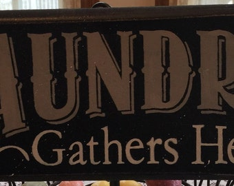 Laundry gathers here. Hand painted sign