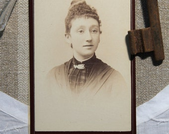 antique French Sepia photograph of a lady.