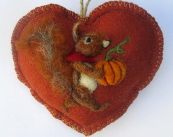 Halloween Heart hanging decoration, needle felted squirrel with a pumpkin on a heart -