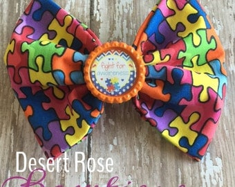 Autism awareness puzzle bow