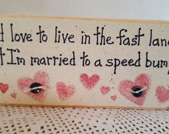 I'd Love to live in the fast lane...but I'm married to a speed bump.