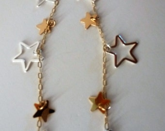 Stardust Shoulder Dusters - a universe of gold and silver stars swinging a full five inches from elegant Euro leverbacks. Starring you!