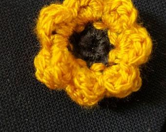 Golden flower lapel pin