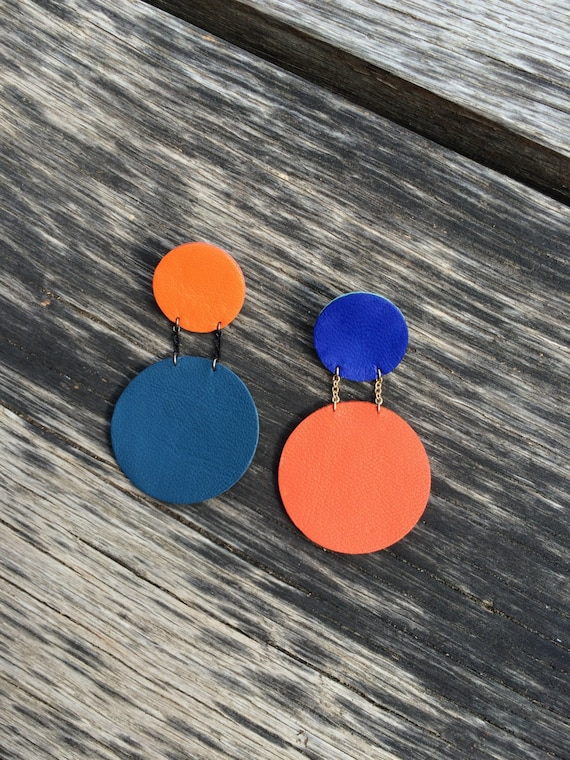 Steel blue and orange statement circle leather earrings
