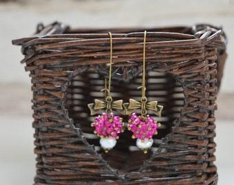 Pink white rondelle dangle earrings
