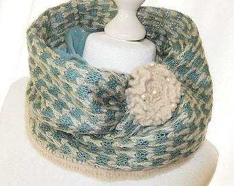 Loop knit in teal with brooch