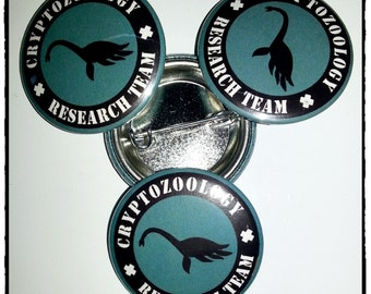 "Loch Ness Monster - Cryptozoology Research Team 1.25"" (31.7mm) Pinback Button"