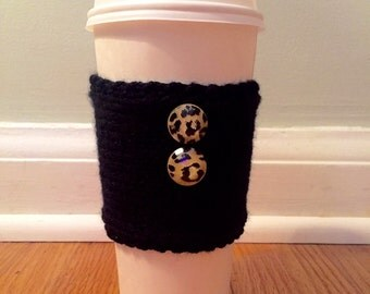 handmade knitted coffee cozy with leopard buttons (in black)