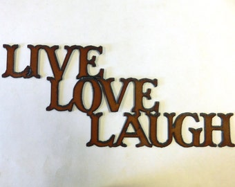 Live love laugh sign made out of rusted metal