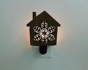 Snowflake nightlight with image cut into rusted metal