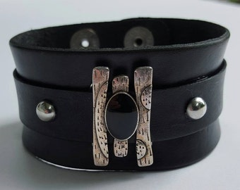black leather cuff, with silver and black stone focal