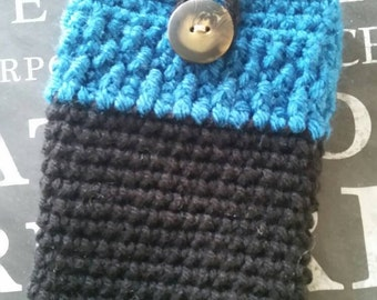 Cell phone case. Blue and Black with a unique button.  Handmade crocheted smartphone cozy. Stylish phone case.