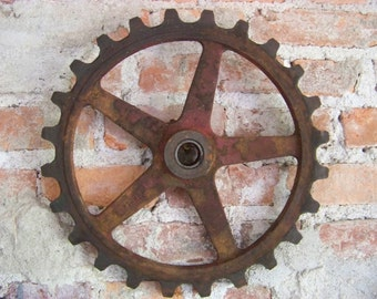 Very cool rusty red gear/sprocket