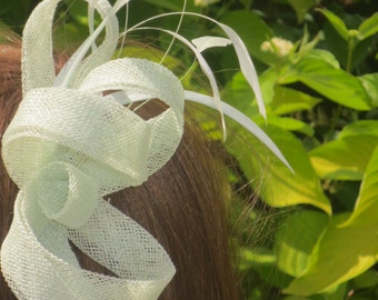 Mint green sinamay loops and feathers.On Alligator clip.
