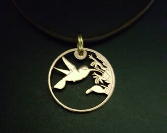 Coin jewelry Hummingbird cut from a Trinidad and Tobago penny