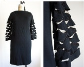 40% OFF SALE 1960s vintage mod cutout black dress / size medium large