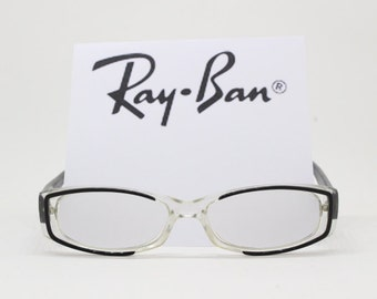 Ray Ban glasses, transparent acetate frame with black arms and outline. Prescription spectacles Raybans, Ray-Ban, Ray bans, Rayban.