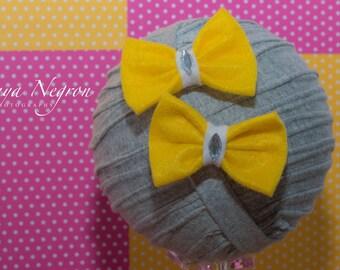 Yellow felt clips with diamond center