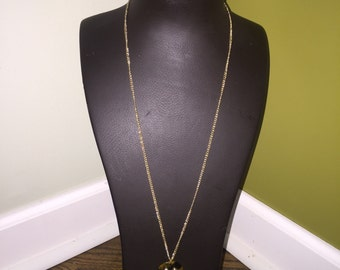 Long chain with tortoise shell pendant