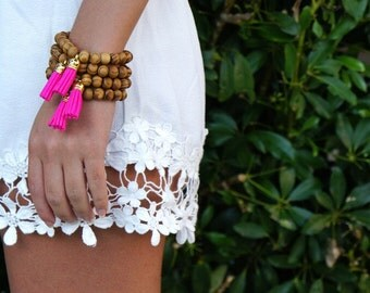 Wood Beaded Bracelet with Neon Pink Tassel attached