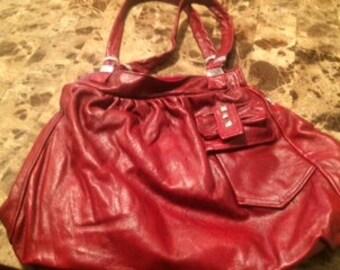 HeavyCarrier red leather handbag