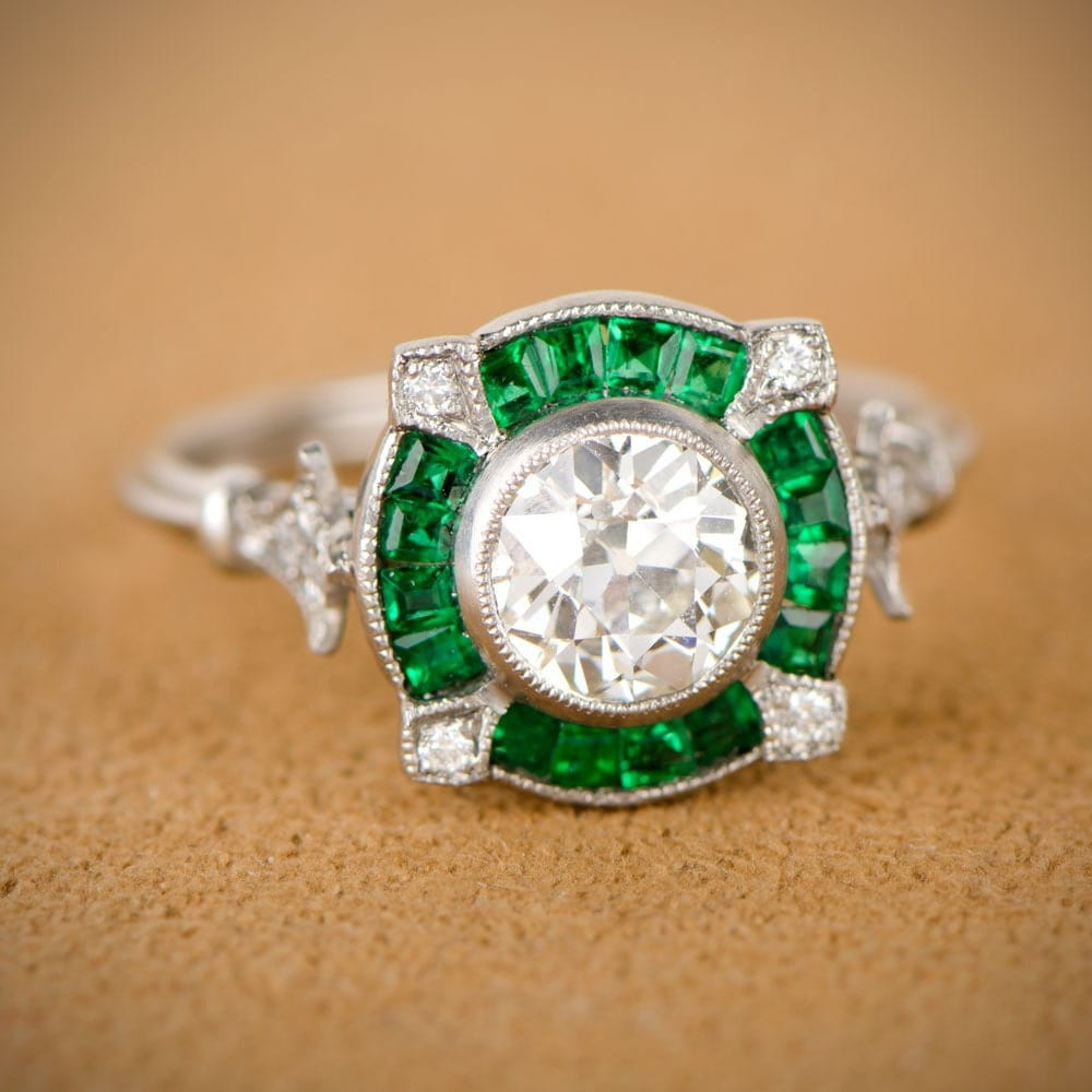 emerald and halo engagement ring