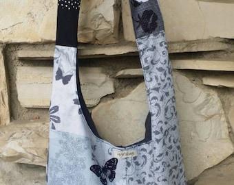 Hobo across the body bag,  blue, black and white butterfly, floral print. Reversible bag, hobo bag, boho bag, slouch bag, handbag