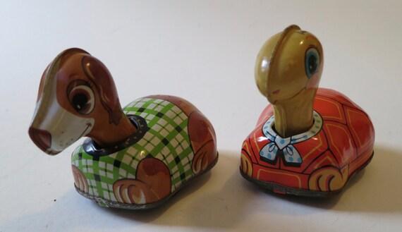 Two Japanese friction toys One dog, one turtle.