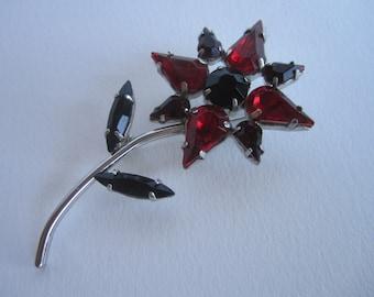 1950s red and black rhinestone flower brooch