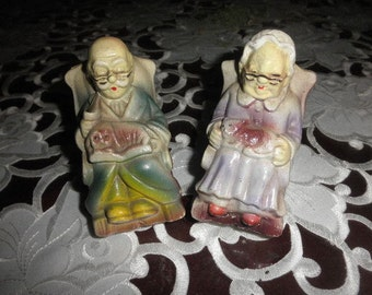 Old Man and Woman in Plastic Coin Bank