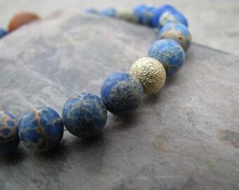 Blue stone bead stretch bracelet, bohemian jewelry, stacking bracelet, layering, 14 k gold filled bead, impression jasper, hippie chic