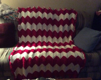 Rouge and pale white afghan
