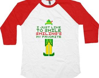 Buddy The Elf T Shirt Christmas movie T shirt Smiling is my favorite 8 bit Christmas movie quote American Apparel  Baby Youth Raglan TM-100