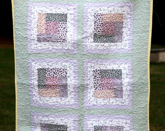 Purple Floral and Green Quilt