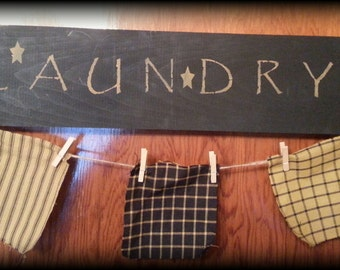 Black and mustard wooden laundry sign