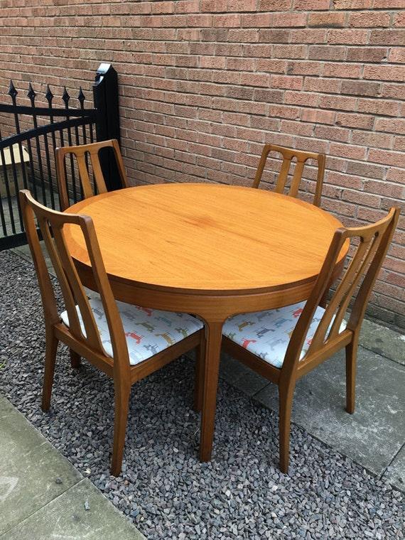Teak table and chairs retro teak round table extending - Round teak table and chairs ...