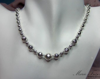 Hammered sterling silver beads and Swaovski crystals necklace
