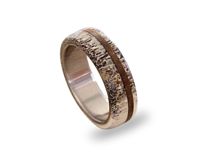 Titanium ring with antler and oak wood inlays off-center